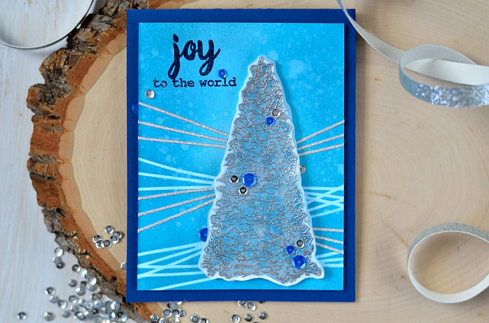 Add shine and frigidity to a Christmas tree by silver embossing it on vellum. Altenew Sketchy Evergreen. Card by @s_shayevich