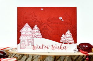 \Create winter village scene by embossing holiday houses in the background. Card by @s_shayevich\
