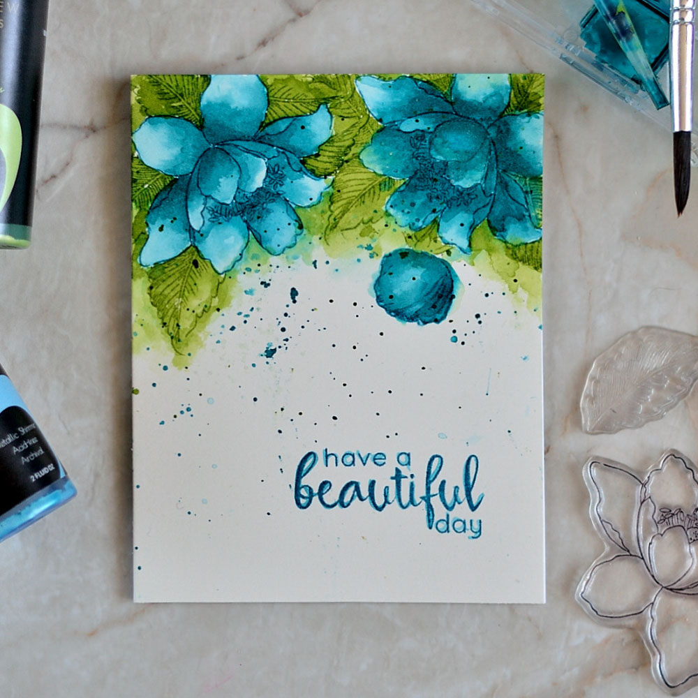 Create watercolor like look by stamping an outlined design with Altenew inks and coloring with matching sprays. Card by @craftwalks