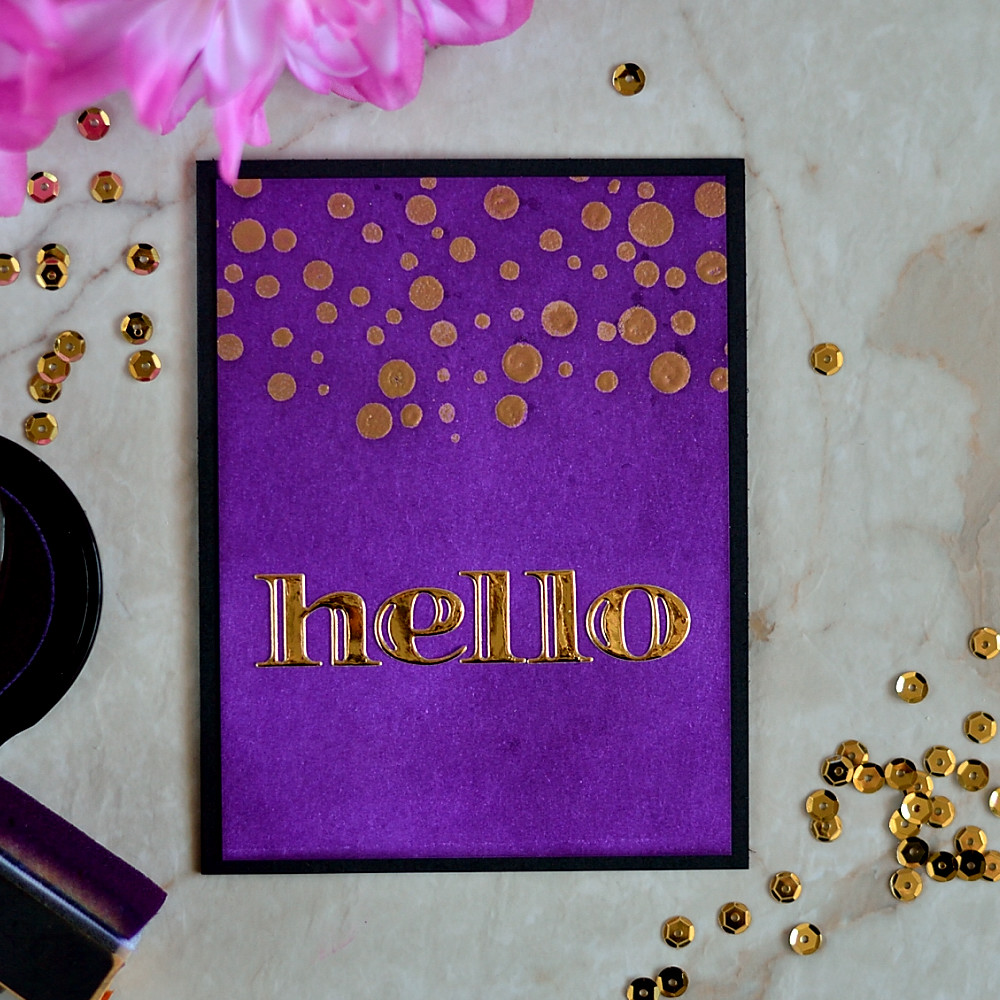 Create a velveteen like look by inking a panel with Altenew Midnight Violet ink and add a luxurious look with gold embossed sentiment and gold letter die cuts. Card by @craftwalks.