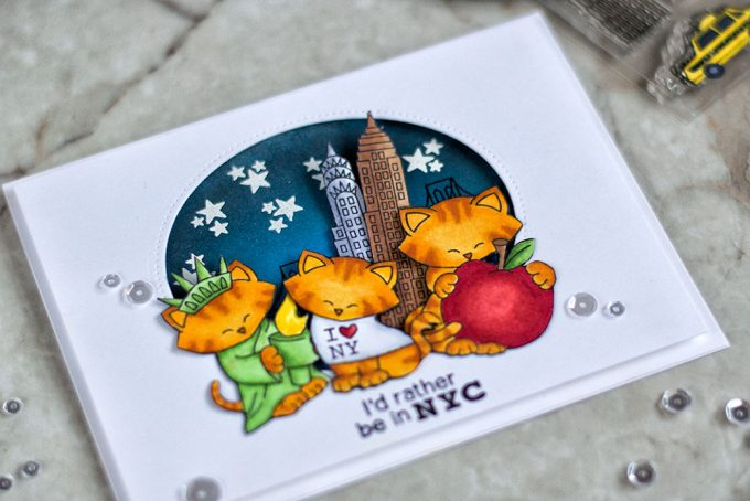 Fun and cute card featuring NYC tourist activity. With Newton's Nook Designs and Studio Katia dies and sequins. Card by @craftwalks.