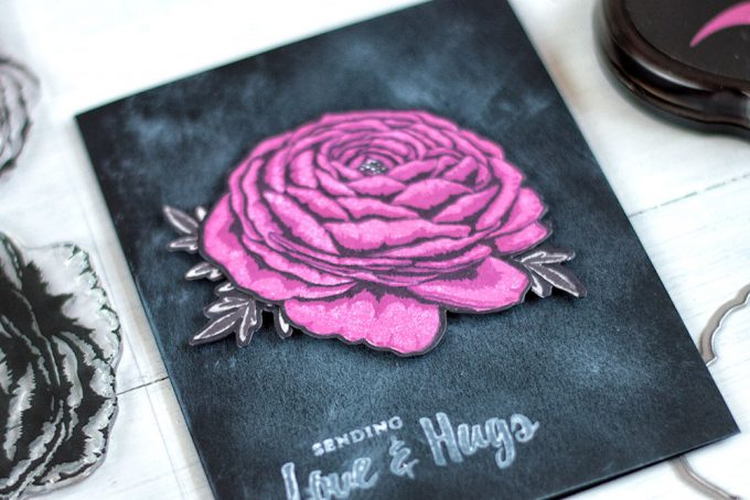 Make a dramatically looking card by stamping a flower with dark inks and placing it on dark chalkboard background. With Altenew Build-A-Flower: Ranunculus. Card by @craftwalks