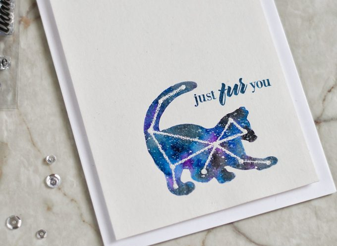 Create an interesting card for a cat lover by using negative mask to create a galaxy piece and then white emboss simple drawn constellation. With Altenew Modern Cats Card by @craftwalks.