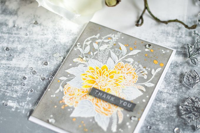 Beautiful Altenew Blooming Bouquet made in yellow and white onto a gray background. Two ways of masking is used here. Clear embossing and masking liquid. Card by @craftwalks