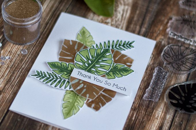 Gold monteras are very trendy now. Combine them with green tropical leaves to create a stylish and modern card. With Altenew Parrot Paradise Stamp Set. Card by @craftwalks