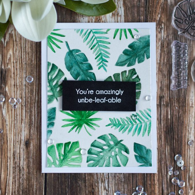 Create a tropical card by watercoloring tropical leaves from Altenew Parrot Paradise Stamp Set. Card by @craftwalks
