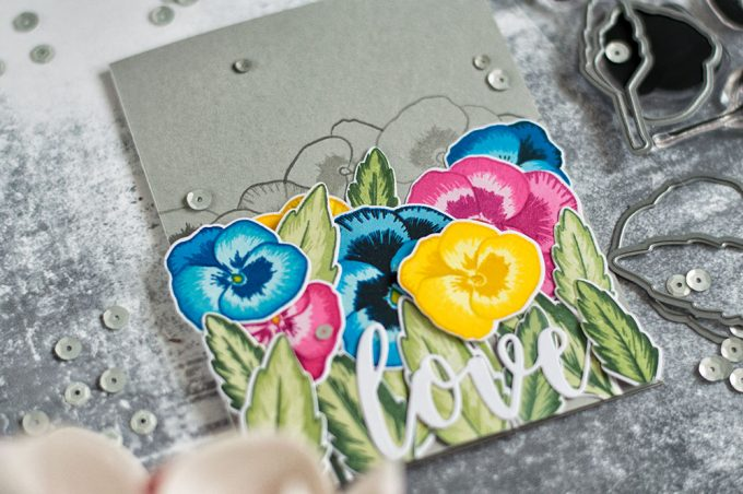 Colorful pansies field on a gray card base. With Altenew Pretty Pansies stamp set. Card by @craftwalks