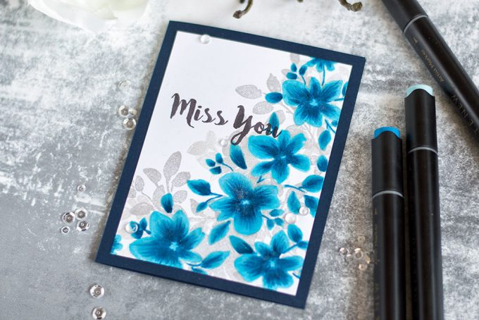 Alter the look of your solid stamped images by adding coloring with markers. With Altenew Floral Shadow. Card by @craftwalks