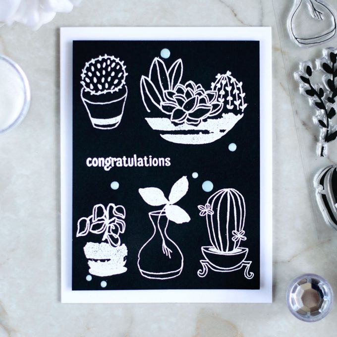 Create a quick and stylish card with white embossing on black. With Altenew Indoor Garden Stamp Set. Card by @craftwalks