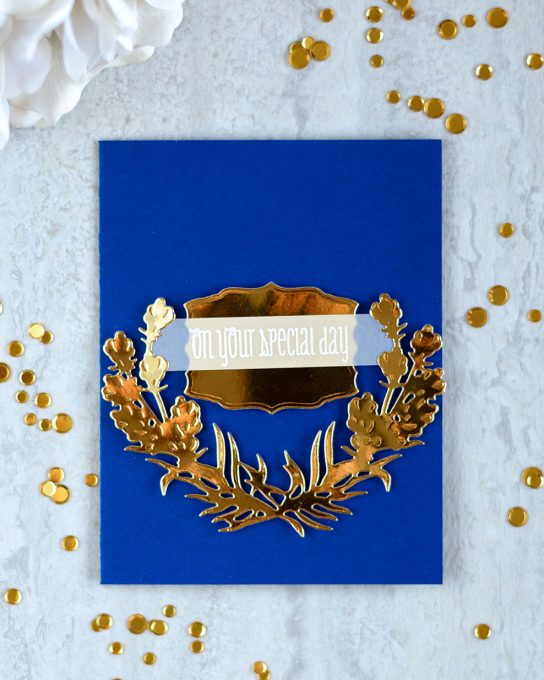 Gold and blue is always a winning combination. Especially if you want to create something luxurious but severe. Made with Spellbinders Shapeabilities Lavender Swag Etched Dies. Card by @craftwalks
