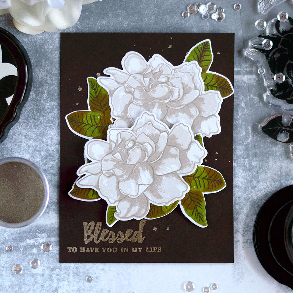 ​ Create a dramatic card with white Gardenias from Altenew on dark brown background. Card by @craftwalks