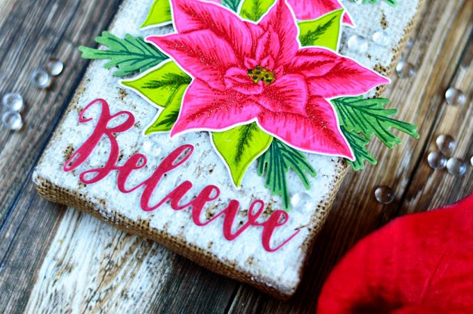 Holiday decor piece on a burlap panel with Altenew Build-A-Flower Poinsettia, Card by @craftwalks