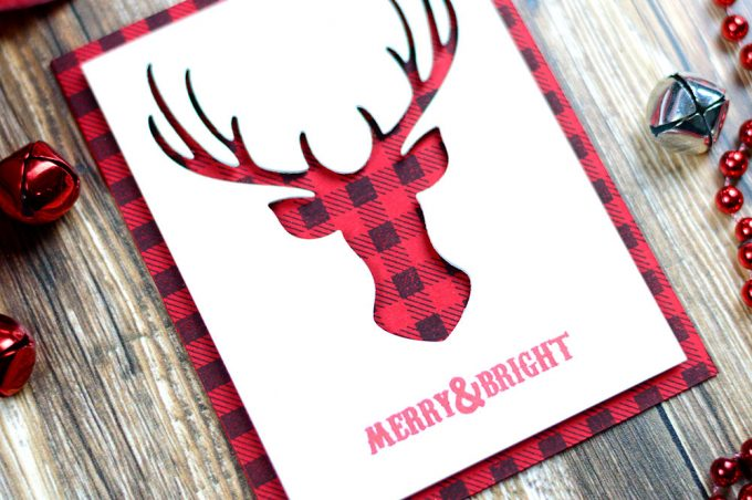 Simple, quick and easy Christmas card featuring plaid plaid background and deer antlers. Card by @craftwalks
