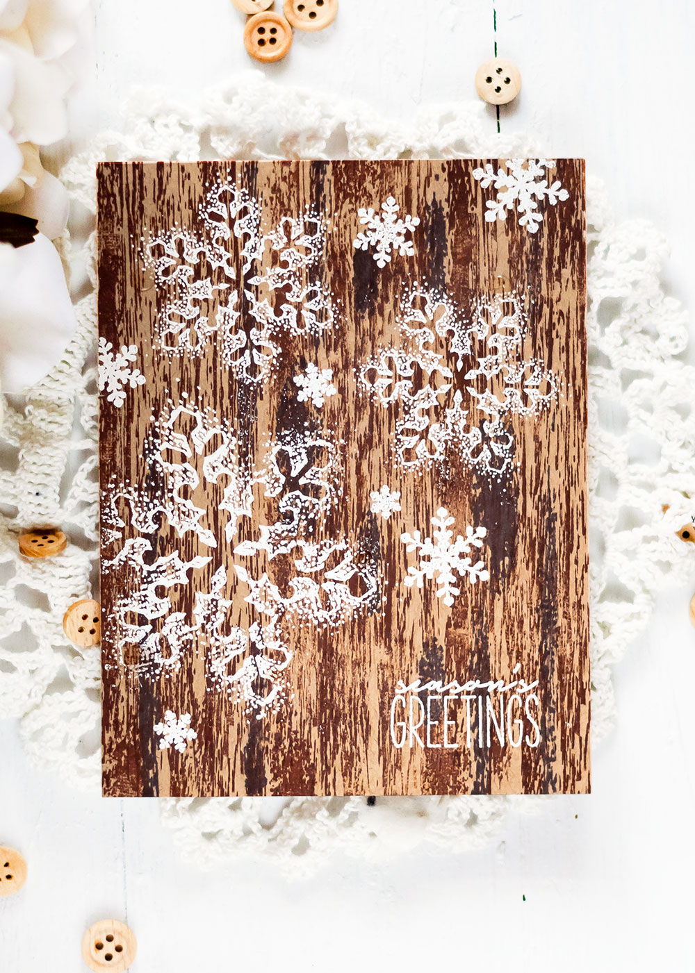 Holiday Card with The Ton Blizzard Hugs. White embossing on woodgrain. Card by Svitlana Shayevich