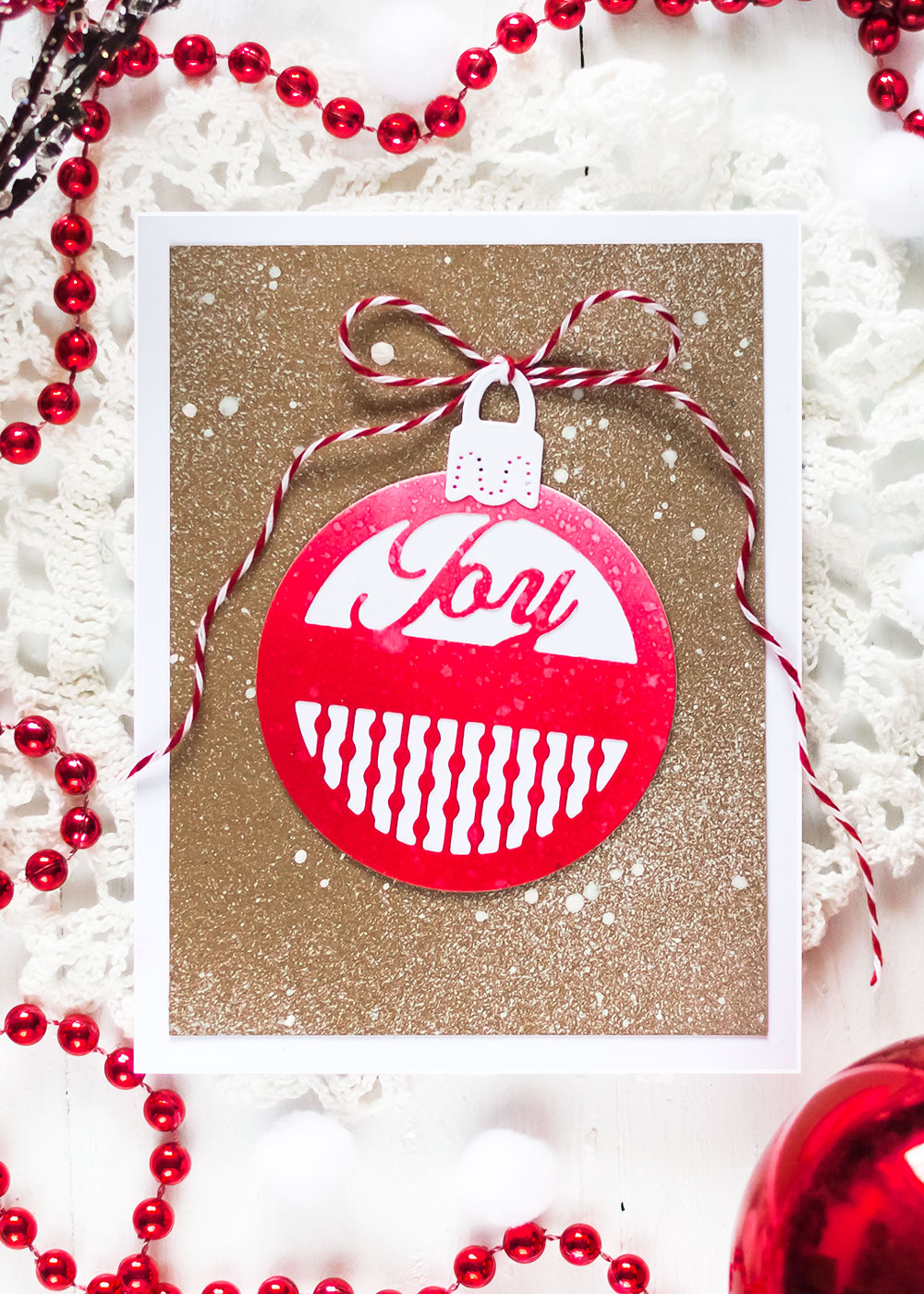Red ornament on kraft. Spellbinders A Charming Christmas Collection Becca Feeken. Card by Svitlana Shayevich