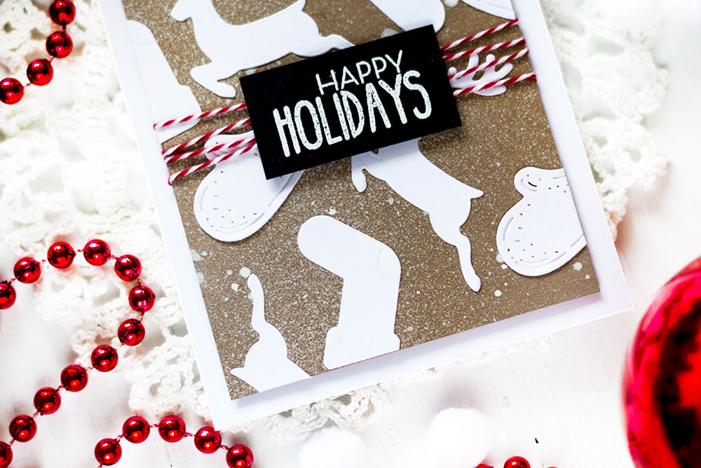 White on Kraft background of die-cuts. Spellbinders A Charming Christmas Collection Becca Feeken. Card by Svitlana Shayevich