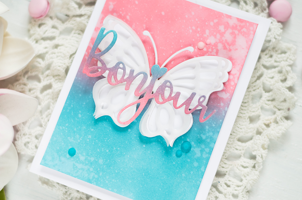 Vellum layered butterfly on distress oxide background with Spellbinders Large Die Kit. Card by Svitlana Shayevich