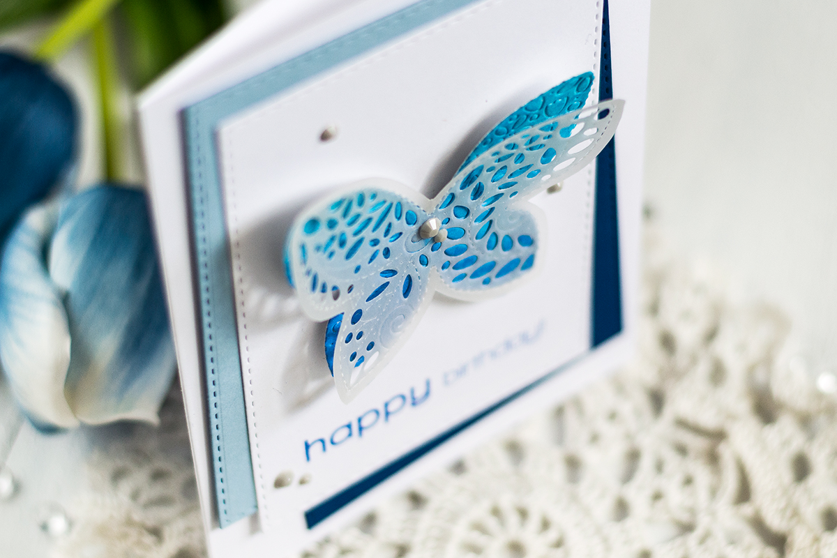 Create a clen and simple card with layered butterfly of a vellum and colored pieces. Card by Svitlana Shayevich