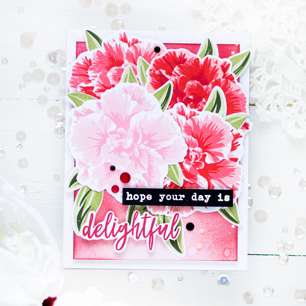 Red monochromatic card featuring layered camellia japonica. Card by Svitlana Shayevich