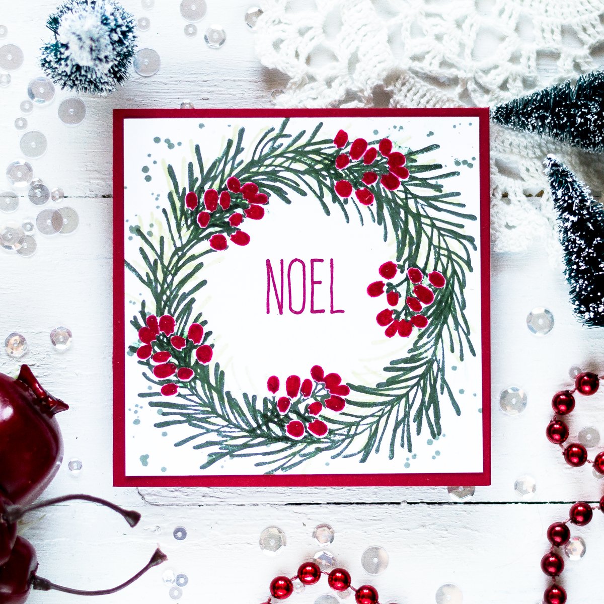 Holiday wreath card using non holiday stamps featuring clear embossing resist. Card by Svitlana Shayevich