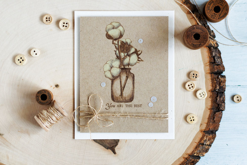 Color a stamped image with pencils of brown shade on a kraft cardstock to get an interesting result of a sketch like image. Cotton branches in jar. Card by @craftwalks.